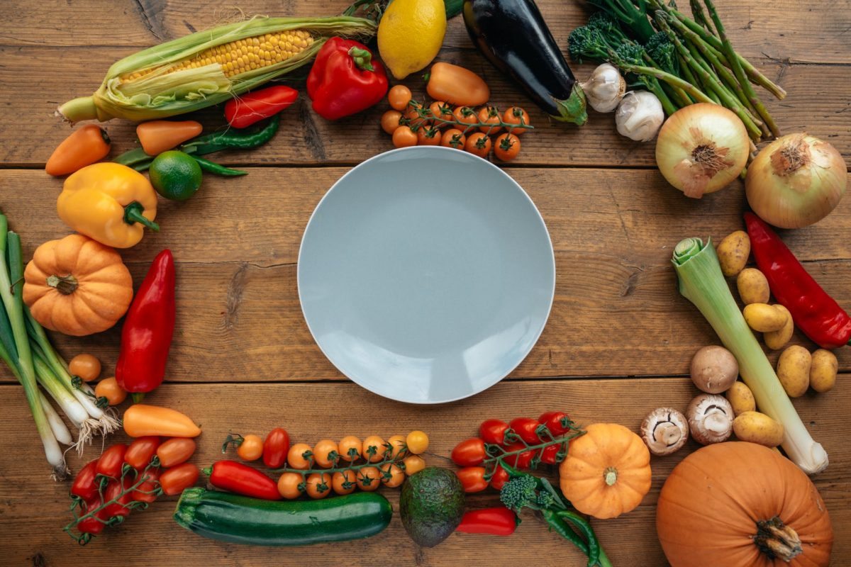 fresh healthy vegetables composed on table with white plate